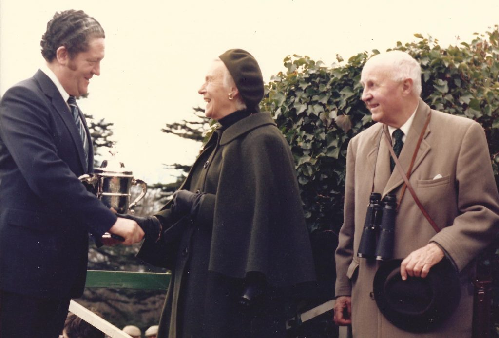 Lord and Lady Donoughmore being congratulated by Brian Lenehan, after their horse Orchestra won The Rank Cup at The Phoenix Park and became the first winner for John Oxx in 1979.